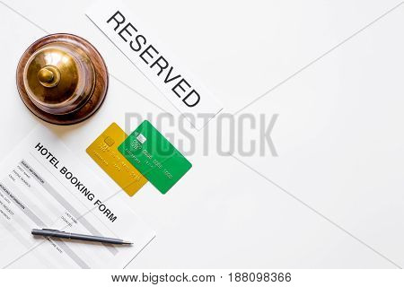 hotel reception desk with booking form on white background top view mock-up