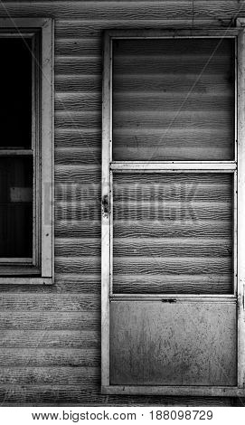 Grey scale image the back door of a building