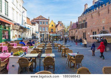 Bruges Belgium - 11 April 2017 - People enjoy their day along street and shops at Bruges world heritage city of Belgium on a fine spring day of April 11 2017
