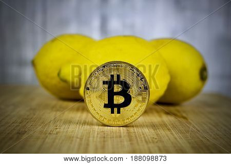 Gold Bitcoin Coin And Lemons