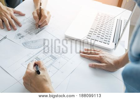 Architects Engineer Discussing At The Table With Blueprint - Closeup On Hands And Project Print, Tea