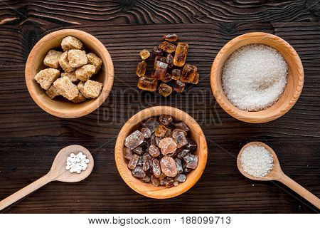 sugar in lumps for sweet food cooking on kitchen wooden table background top view