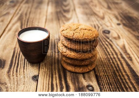 Oatmeal Cookies With Milk On A Wooden Background