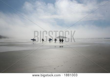 Surfers In Tofino, Bc