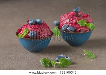 Frozen Red Sorbet, Berry Ice Cream In A Blue Cup With Mint And B