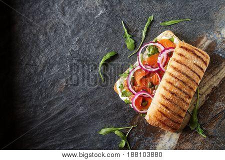 Homemade Baguette With Smoked Salmon, Onions And Arugula. Dark B