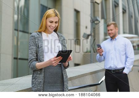 Two cheerful happy young business people taking online meeting outdoor.