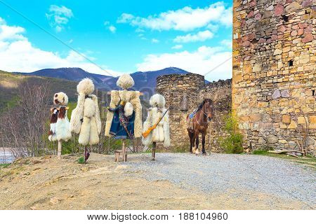 traditional Georgian shepherd dress, hat or papakha and coat of sheep fur, Ananuri, Georgia