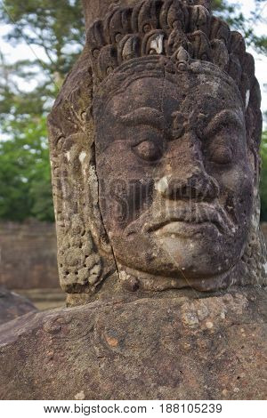 Demon figure in Angor Thom Temple Cambodia.
