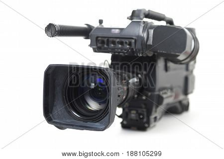 professional video camera for TV productions isolated with shadow on a white background selected focus narrow depth of field