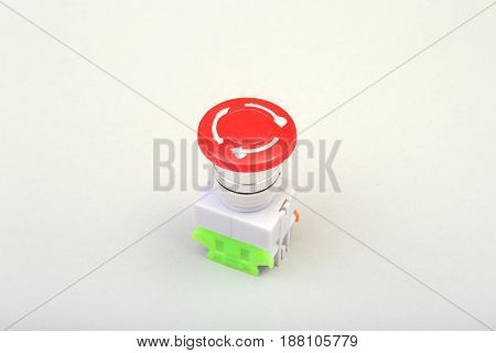 Close-up emergency stop button isolated on white background