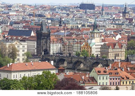PRAGUE CZECH REPUBLIC - MAY 1 2017 : Charles Bridge on Vltava river aerial view. Its construction started in 1357 under the auspices of King Charles IV. It is the most popular bridge in Prague there are always many tourists.