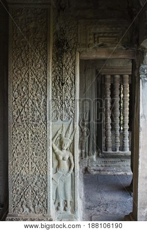 Wall carving detail in Angkor Wat Temple Cambodia.