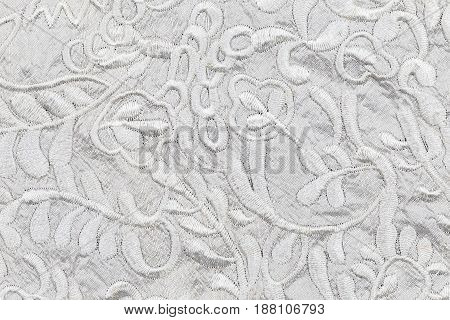 White fabric texture with silhouettes. Top view