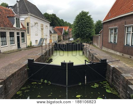 Historical water Canal in Edam city, Holland