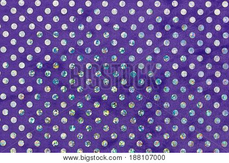Purple fabric with brightly colored circles. Top view