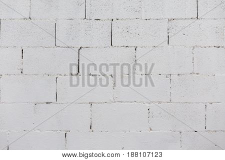 Brick wall painted on white. Front view