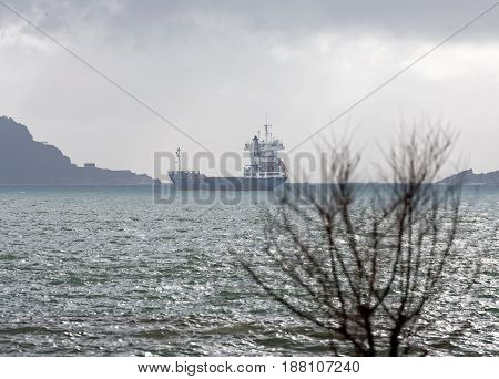 detail of a little ship at anchor in the gulf of la spezia
