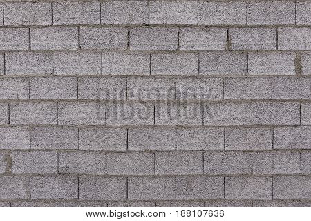 Concrete wall and gray bricks. Front view