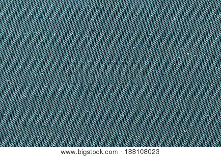 Blue fabric with holes and shiny. Top view