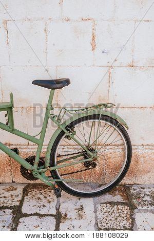 Detail of very old green bicycle in Hvar, Croatia