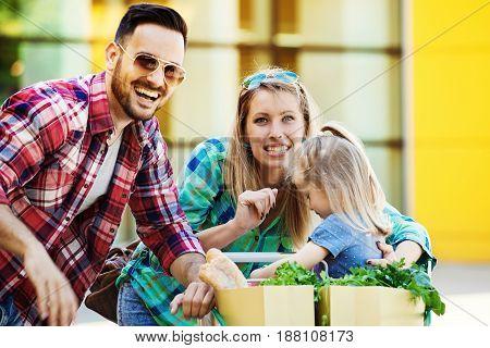 Happy Family In Hypermarket