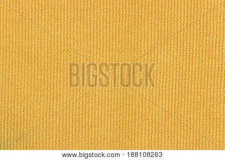 Close texture of yellow cloth. Top view