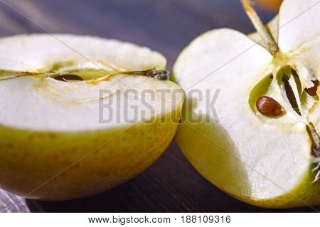Apple. The Apple image. Cut into two halves. Apple lying on a wooden surface. Slice of juicy Apple and delicious. Illustration of healthy food.