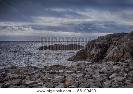 Stony Seashore Alongside Lofoten Islands in Norway During Sunset Hour. Horizontal Image Composition