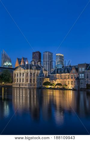 Binnenhof Palace of Parliament inThe Hague in The Netherlands Shot During Blue Hour Time. Against Modern Skyscrapers on Background. Vertical Image