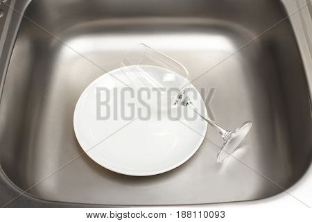 Kitchen Sink With Clean White Plate And Wine Glass
