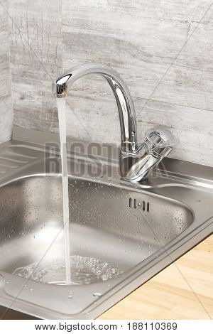 Kitchen Sink With Running Tap Water