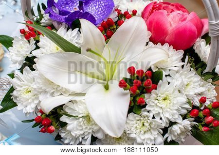 Composition of white lilies and chrysanthemums closeup