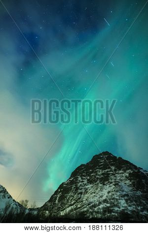 Picturesque Unique Nothern Lights Aurora Borealis Over Lofoten Islands in Nothern Part of Norway. Over the Polar Circle. Vertical Image