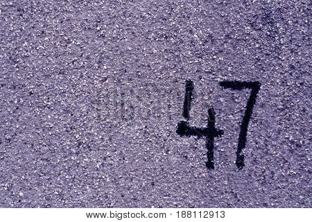 Number Fourty Seven On Blue Plaster Wall.