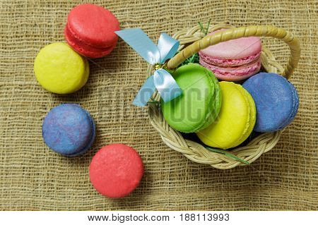 Closeup sweet colorful macarons on the table with pastel