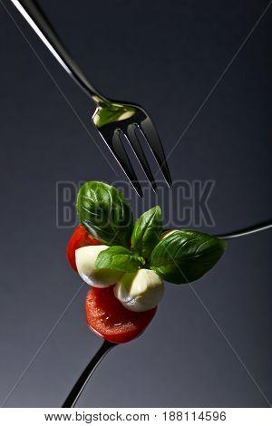 Mozzarella With Tomato Cherry And Green Basil .