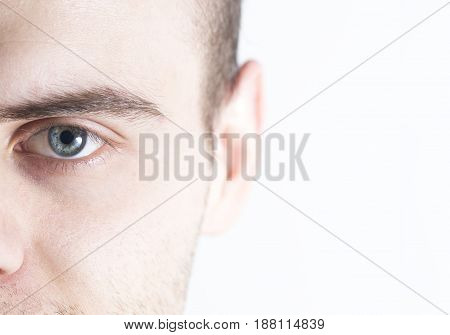 Man looks at the camera on a white background half