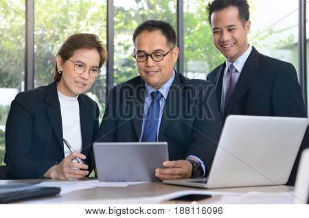 Group of business people discussing and working together during a meeting in office