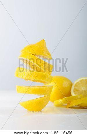 Flying lemon. Sliced lemon on white background. Levity fruit floating in the air