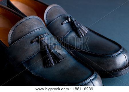 Blue loafer shoes on blue background. One pair. Close up