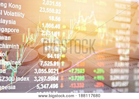 Business, finance, saving or investment background concept : Double exposure of Asia Pacific stock market index, stock exchange graph chart and coins, pen, calculator, saving account passbook