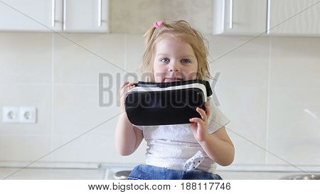 Cute Little Baby Uses a Virtual Reality Glasses in The Kitchen