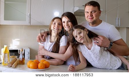 Happy Family at Home in Kitchen, Smile and Looking at Camera