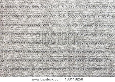 Horizontal gray knitting fabric texture background or knitted pattern background. Knitting or knitted background for design. Knitting pattern or knitted pattern for design. Small knit texture.
