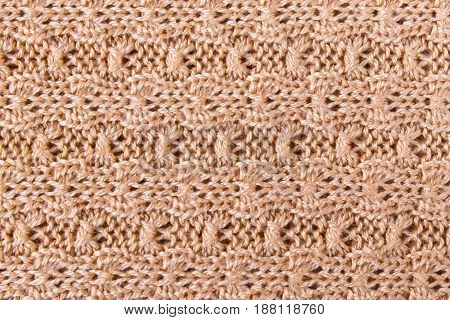 Brown knitting fabric texture background or knitted pattern background. Knitting or knitted background.  Knitting pattern or knitted pattern for design. Small vintage brown knit texture or knit pattern.