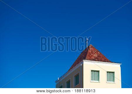 Steeple of a church against a clear blue sky
