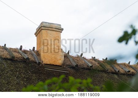 typical thatched roof with chimney in the old fishermen's village of Kikhavn