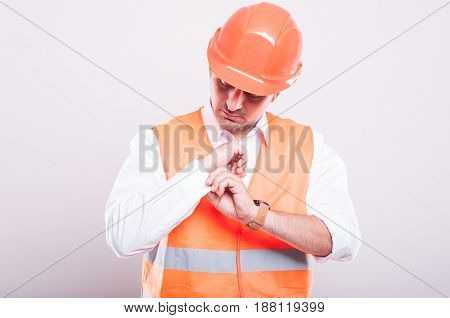 Foreman Wearing Reflective Vest Arranging Shirt Button