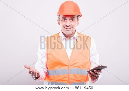 Foreman Wearing Reflective Vest Looking Confused Holding Smartphone